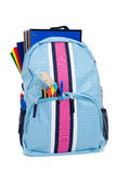 Backpack with school supplies on white Stock Photography
