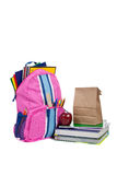 Backpack with school supplies on white Royalty Free Stock Images