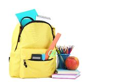 Backpack with school supplies stock images