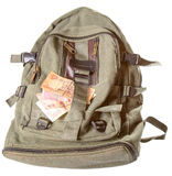 Backpack and several notes of the Ukrainian money Stock Image