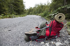 Backpack at the side of the austral road. Backpack at the side of the austral road, Chile Stock Images