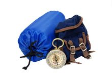 Backpack, sleeping bag and compass. Backpack with rolled up sleeping bag and compass for overnight trips - path included stock photo