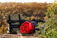 Backpack and sleeping bag on ground outdoors. Camping equipment royalty free stock photos