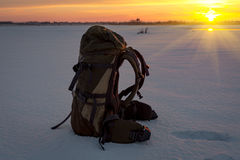 Backpack on snow Royalty Free Stock Photo