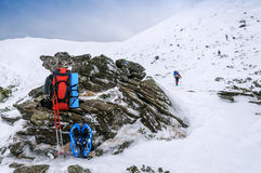 Backpack, snowshoe and mountain Stock Photography