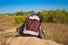 Backpack in a steppe Stock Images