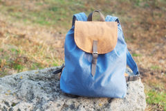 Backpack on the stone. Handmade backpack on the stone photographed close-up Stock Photos