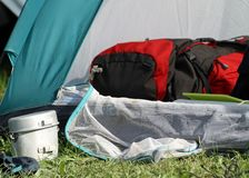 Backpack in the tent and a aluminum lunchbox Royalty Free Stock Photo