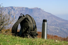 Backpack and thermos Royalty Free Stock Photos