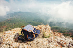 Backpack on top of the mountain. Travel backpack on top of the mountain Stock Image