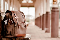 Backpack on the train station ,alone and wait to travel,Hipster Royalty Free Stock Images
