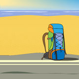 Backpack. Travel bag on the road near the beach and ocean Royalty Free Stock Photo