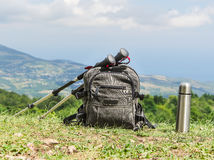 Backpack and trekking poles Royalty Free Stock Photography