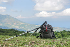 Backpack and trekking poles Royalty Free Stock Photos