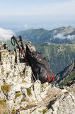 Backpack and trekking poles Royalty Free Stock Photo