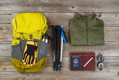 Backpack with walking accessories on rustic wooden boards Stock Photos