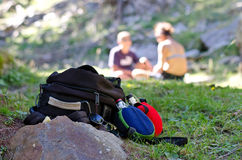 Backpack and water bottle resting on the ground. Val passiria backpack and water bottle resting on the ground Stock Photos