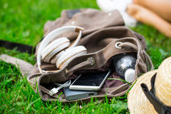 Backpack with water, mobile phone and powerbank inside Royalty Free Stock Photo