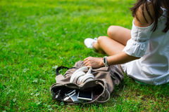 Backpack with water, mobile phone and powerbank inside Stock Images