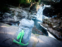 Backpack By The Waterfall Stock Photography