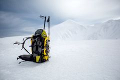 Backpack in wintertime against big snowy mountain.  Royalty Free Stock Images
