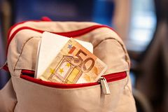Free Backpack With Ticket, Money 50 Euros In Pocket Royalty Free Stock Photography - 142998287