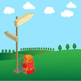Backpack with wood guide post on green field tree and clouds Royalty Free Stock Photography