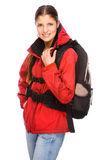 Backpacker. Full isolated studio picture from a young and happy backpacker Royalty Free Stock Image