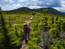 Backpacker on Appalachian Trail in Maine Mountains, Mahoosuc Range stock photo