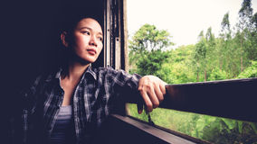 Backpacker Asian woman tired from train travel transportation. Stock Photos