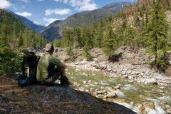 Free Backpacker At Riverside Break Royalty Free Stock Photo - 9160245