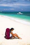 Backpacker on beach Royalty Free Stock Photos