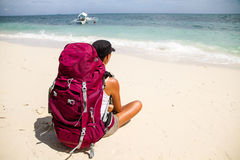 Backpacker on beach Stock Images