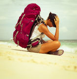 Backpacker on beach Royalty Free Stock Images