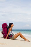 Backpacker on beach Stock Image