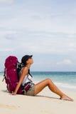 Backpacker on beach Stock Image