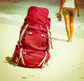 Backpacker on beach. Young backpacker relaxing on the beach Royalty Free Stock Photo