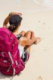 Backpacker on beach Stock Photos