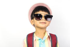 Backpacker Boy with sunglasses ready for summer vacation Stock Photo