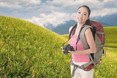 Backpacker with camera Stock Image