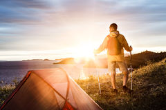 Backpacker in a camp Stock Photos