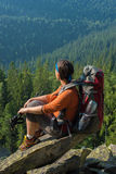 Backpacker on a cliff Royalty Free Stock Images