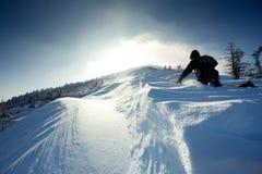 Backpacker  climbs to mountain top Stock Photos