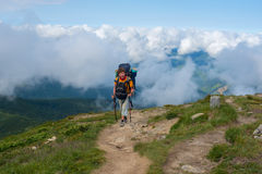 Backpacker climbs to the top Stock Images