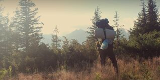 Backpacker in countryside royalty free stock photos