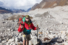 Backpacker crossing Ngozumpa glacier in Nepal. Royalty Free Stock Photos