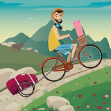 Backpacker in the cycling tour in the mountains Royalty Free Stock Photos