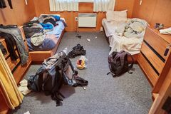 Messy dormitory room. Backpacker dormitory room with mess stock image