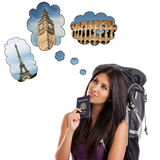 Backpacker dreaming of European trip. A young backpacker with US passport dreaming of her European trip to Paris, London and Rome isolated on white Royalty Free Stock Image