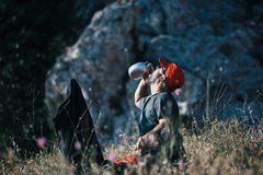 Backpacker drinking water from flask stock image